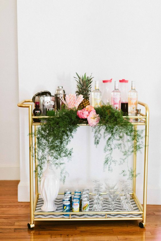 an awesome bar cart styled for a tropical inspired party