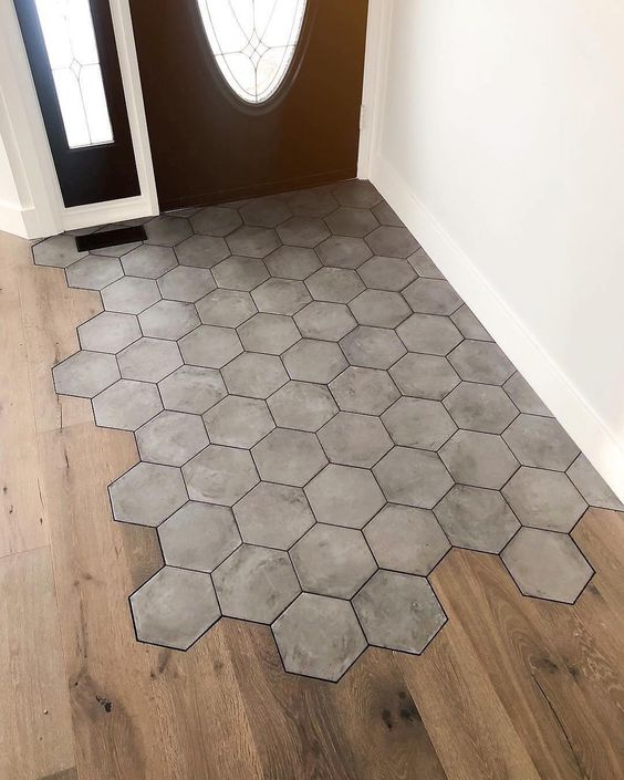 hexagon concrete tiles in the most walkable zone and wooden laminate in the rest of the space
