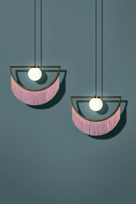 unique pendant lamps with pink fringe and a strong boho meets art deco feel