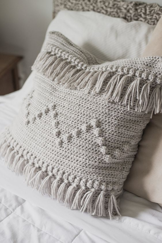 a crocheted boho fringe pillow with patterns is a fun idea for a free-spirited space