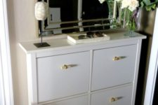 08 a white Hemnes shoe storage piece with new handles gets a fresh look and a new feel