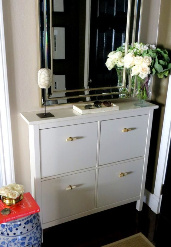 a white Hemnes shoe storage piece with new handles gets a fresh look and a new feel