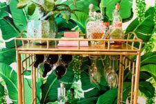 08 place a tropicla potted plant on your cart and voila – your bar cart is done