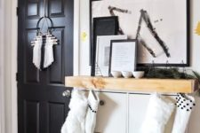 09 add a mantel of light-colored wood to your IKEA Hemnes shoe cabinet to make it bolder