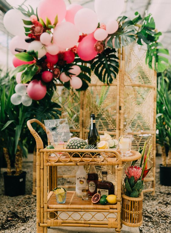 place some pineapples, citrus and torpical blooms on the cart or its sides to give it a tropical feel