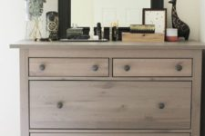 10 an IKEA Hemnes shoe cabinet given a chic look with wood stain and wooden knobs for a rustic feel