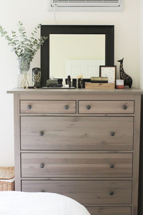 an IKEA Hemnes shoe cabinet given a chic look with wood stain and wooden knobs for a rustic feel