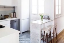 10 geometric black and white tiles in the kitchen with a sharp transition into rich-colored laminate