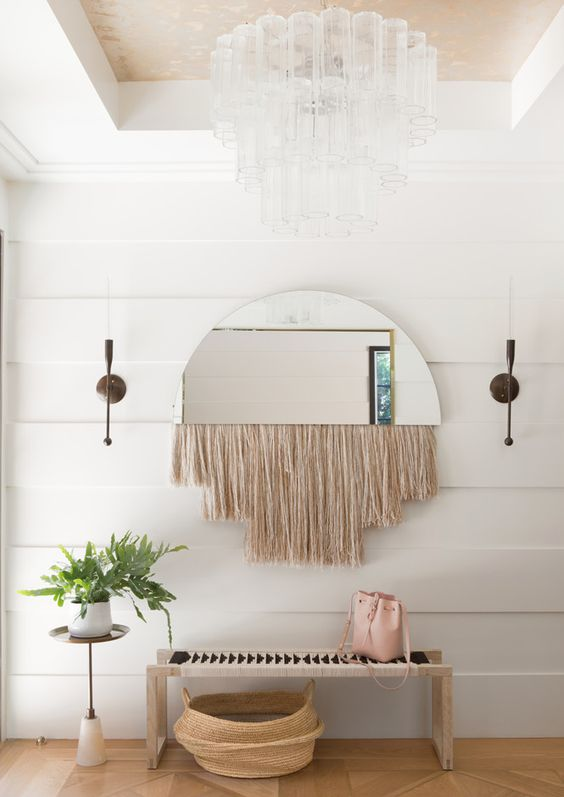a half mirror with long blush fringe is a great idea to spruce up an entryway - it's functional and decorative