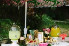 12 a bar decorated with lush tropical greenery and a pink umbrella on top is a simple and modern idea