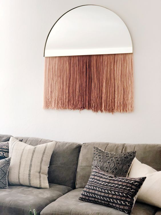 a half mirror with long pink fringe is a cool decoration piece for any space