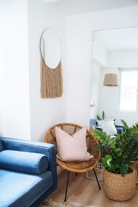 a round mirror with some neutral fringe is a great idea to add a free-spirited feel to the space