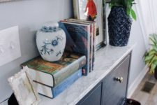 14 glam up your IKEA Hemnes shoe cabinet with navy paint and some marble contact paper plus brass knobs to get a stylish look