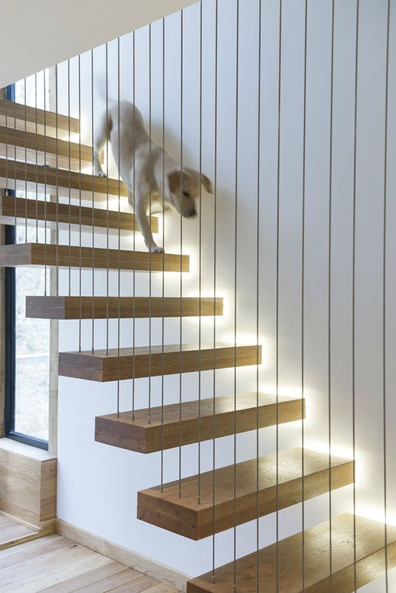 suspension of the staircase is a good idea to avoid installing a banister and railing, add lights