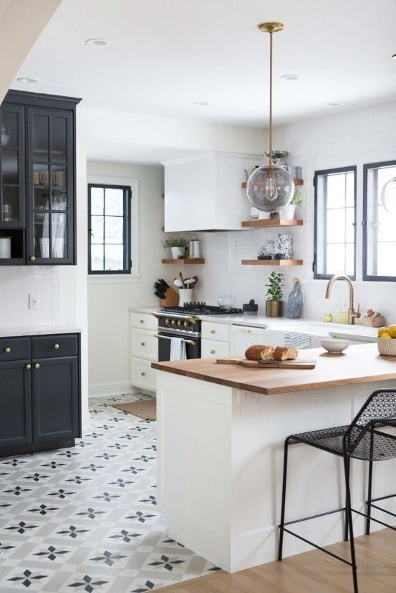 printed mosaic tiles in the kitchen and light-colored laminate with a sharp transition