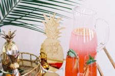 15 style your tropical bar cart with large leaves, a pineapple sign and pineapple accessories