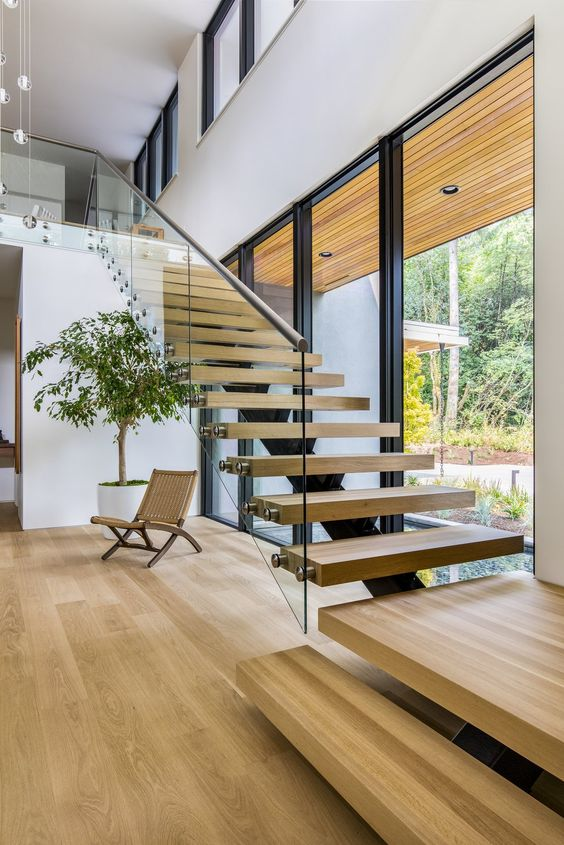 the effect of a floating staircase is achieved with attaching the steps to a glass banister