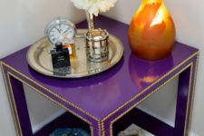 16 a super bright purple IKEA Lack table lined up with decorative nails in gold will be a bold statement