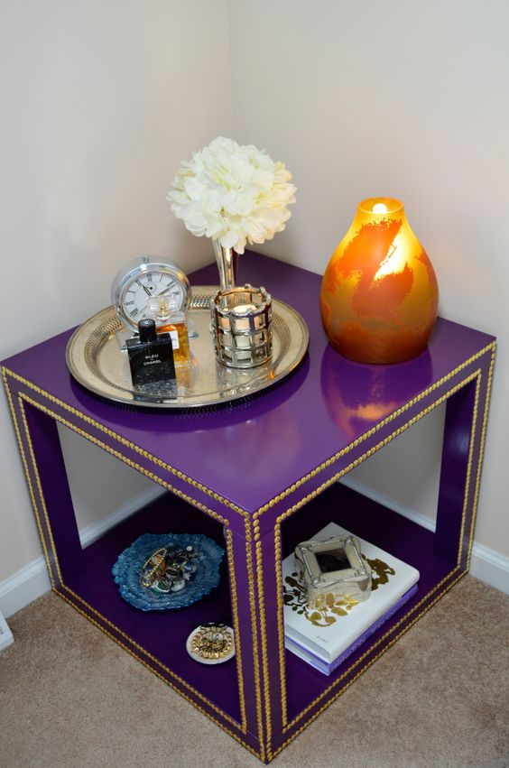 a super bright purple IKEA Lack table lined up with decorative nails in gold will be a bold statement