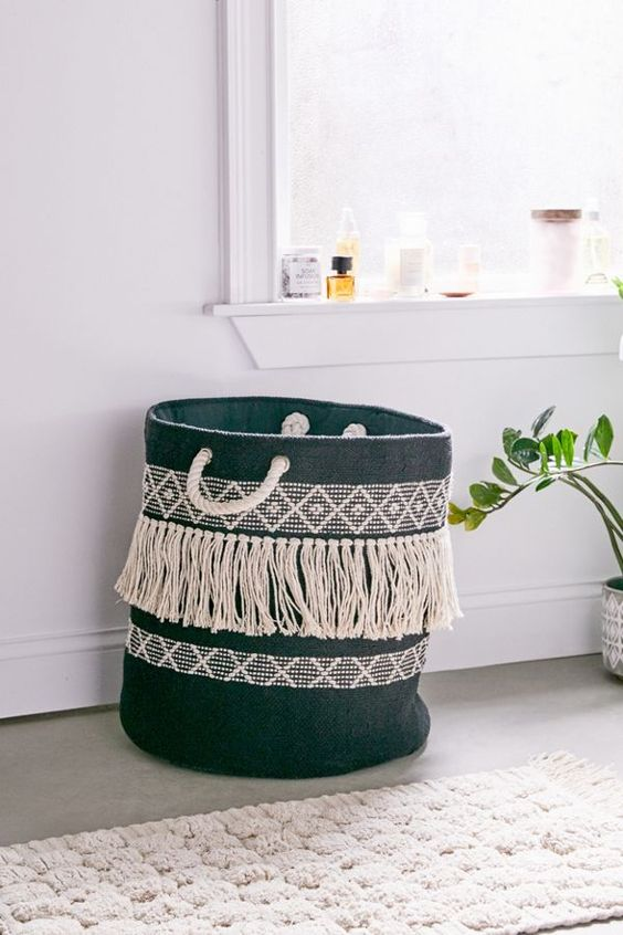 a woven fringe laundry basket is a cool DIY project and a is a bold boho chic idea