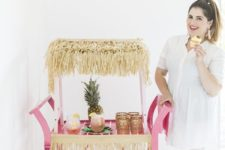 16 this bar cart is styled as a pink tiki, so fun and creative, and a pineapple adds even more