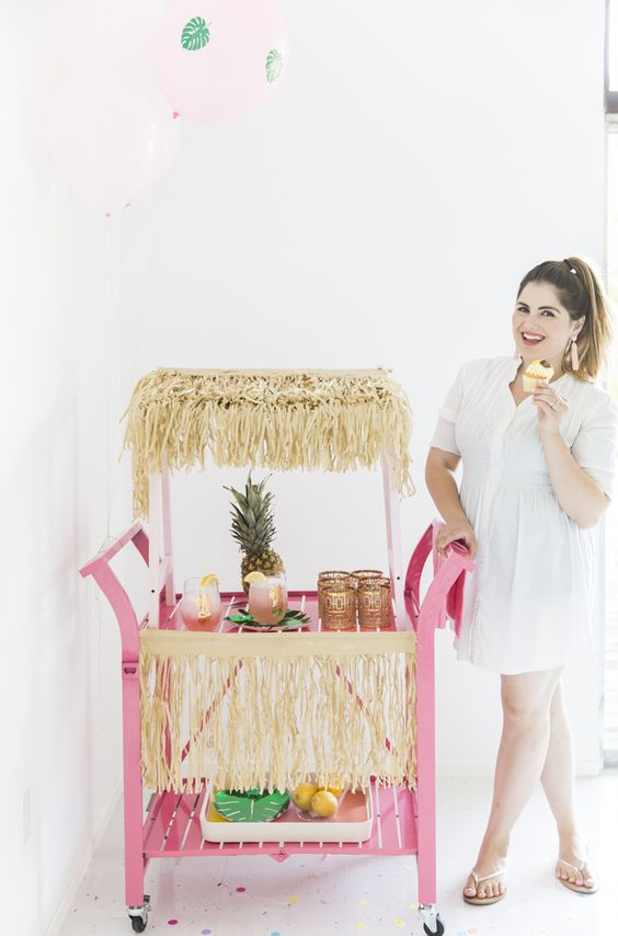 this bar cart is styled as a pink tiki, so fun and creative, and a pineapple adds even more
