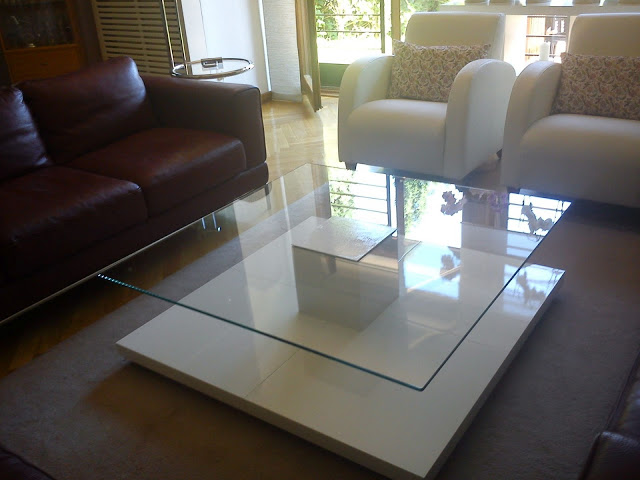 an ultra-modern coffee table made of IKEA Lack and some plexiglass will be a centerpiece of your room