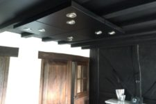 19 a black ceiling lighting done of 4 IKEA Lack tables can fit any room and is a very practical piece