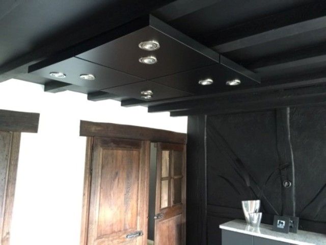 a black ceiling lighting done of 4 IKEA Lack tables can fit any room and is a very practical piece