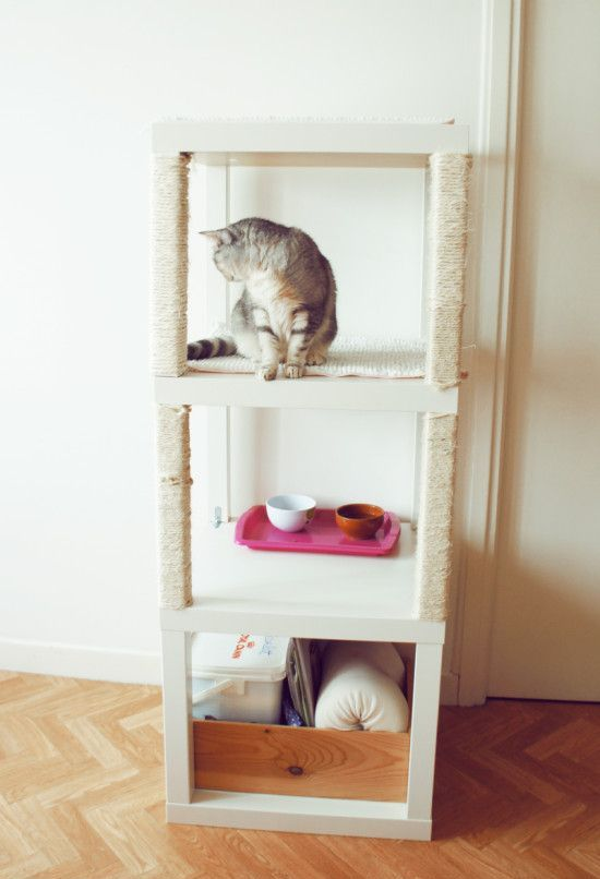 a cute and welcoming cat tower built of several Lack tables includes sleeping, feeding and storage zones