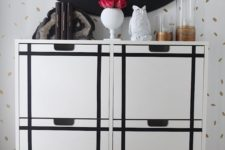 21 an IKEA Stall cabinet hacked with black stickers to form a pattern is a chic and bold modern idea to try