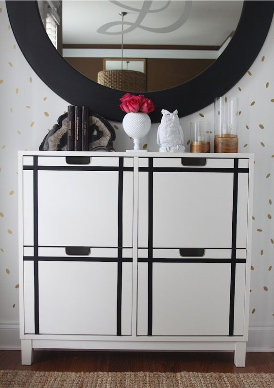 an IKEA Stall cabinet hacked with black stickers to form a pattern is a chic and bold modern idea to try