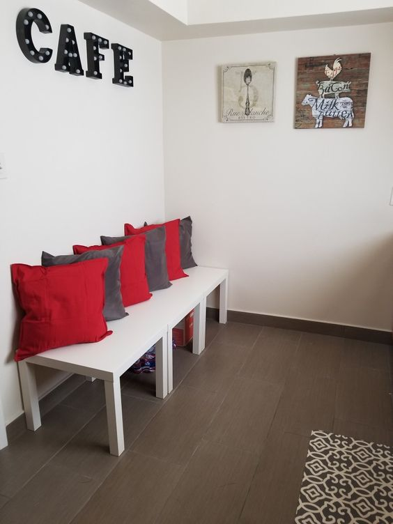a kitchen lounge area made of several Lack tables and colorful pillows is a very easy DIY