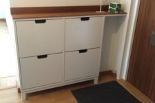22 revamp your IKEA Stall cabinet with a simple rich-colored wooden countertop to give it a chic look