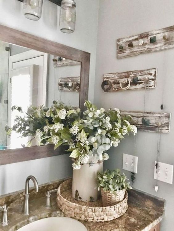 spring bathroom decor with a lush floral centerpiece and succulents in a pot plus a woven tray