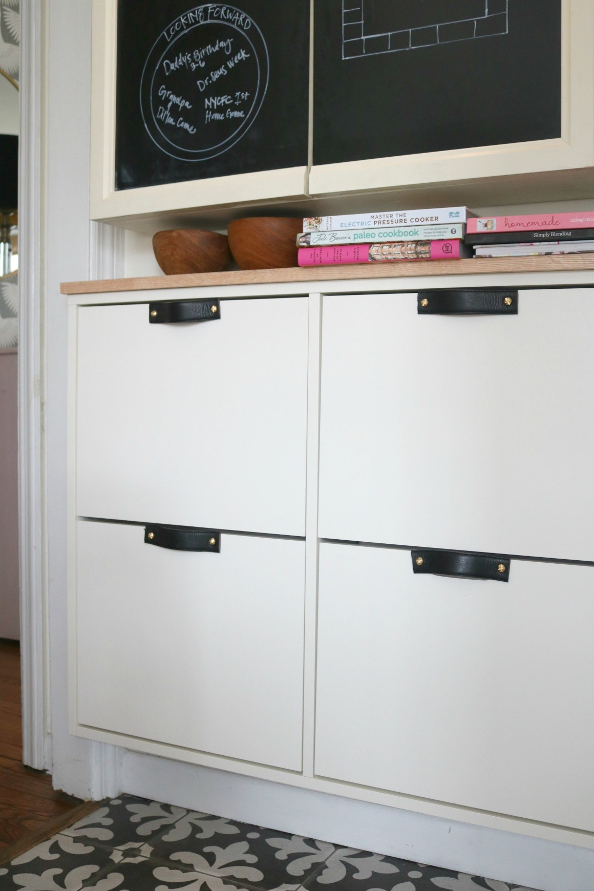 a stylish modern IKEA Stall hack with black leather handles and a wooden countertop for a chic look