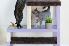 24 a stylish pastel cat condo made of IKEA Lack tables in lilac with scratchers and beds