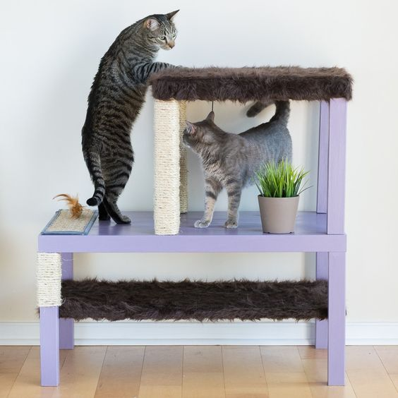 a stylish pastel cat condo made of IKEA Lack tables in lilac with scratchers and beds