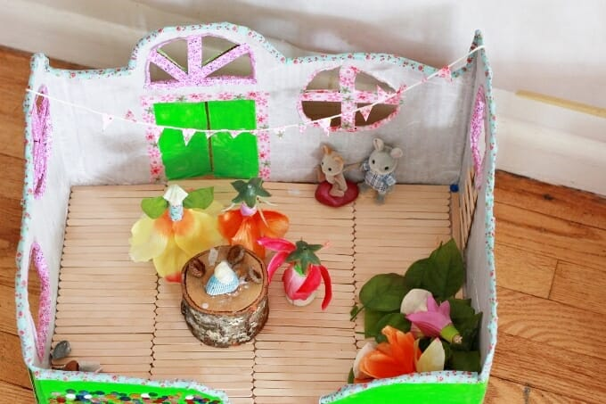 DIY colorful and glitter cardboard box fairy houses (via artfulparent.com)