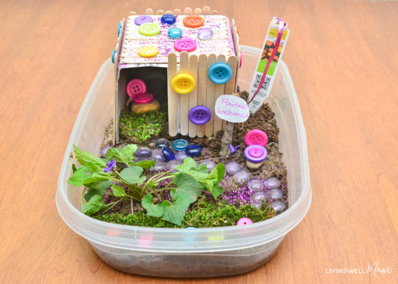 DIY fairy house using sticks and moss (via livingwellmom.com)