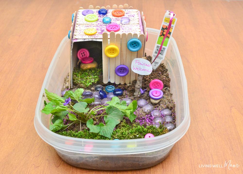 DIY fairy house using sticks and moss