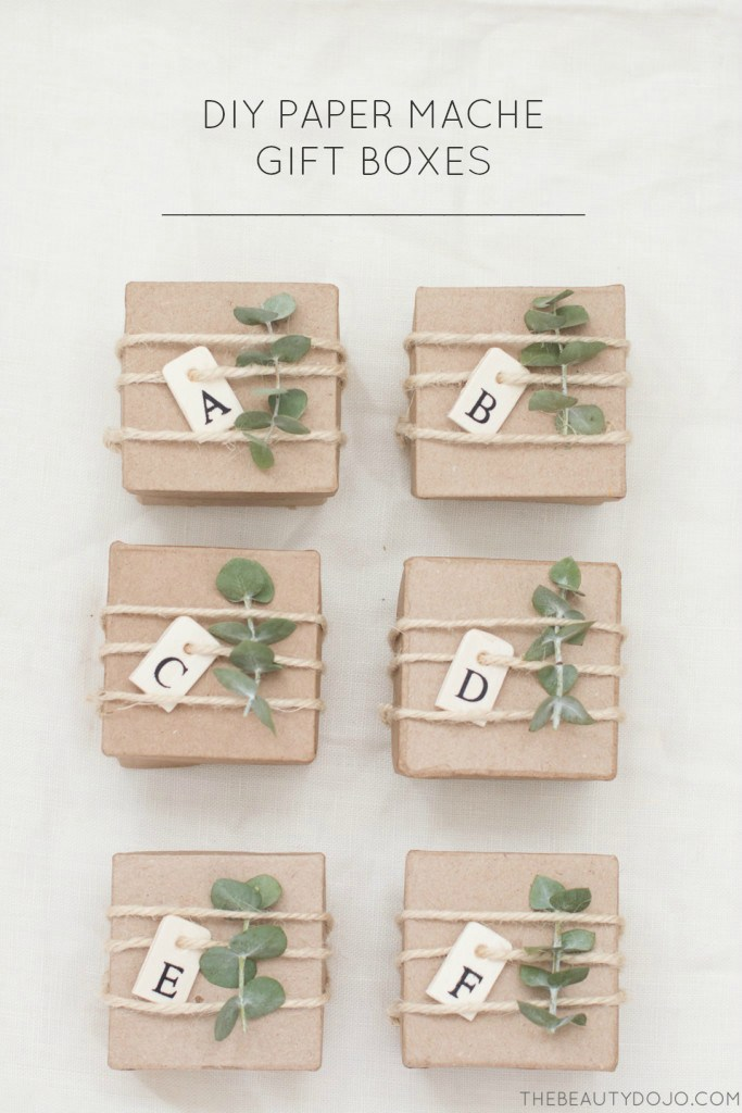 DIY neutral paper mache gift boxes with fresh sprigs and letter tags