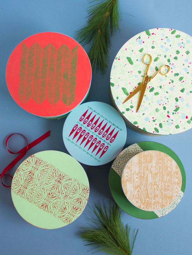 DIY stenciled paper mache Christmas gift boxes (via www.designimprovised.com)