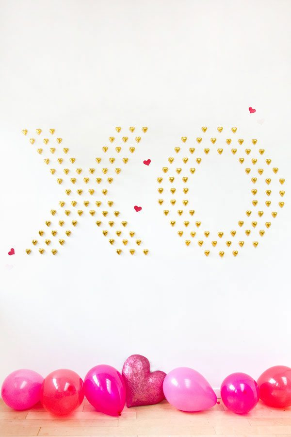 DIY chocolate XO and heart wall as a Galentine party backdrop