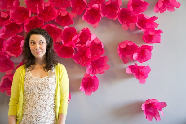 DIY pink tissue paper flower photo backdrop (via lovelyindeed.com)
