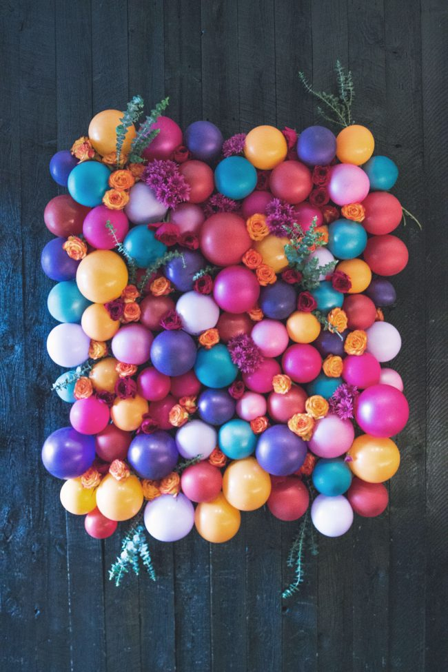 DIY colorful floral and balloon backdrop (via sisoo.com)