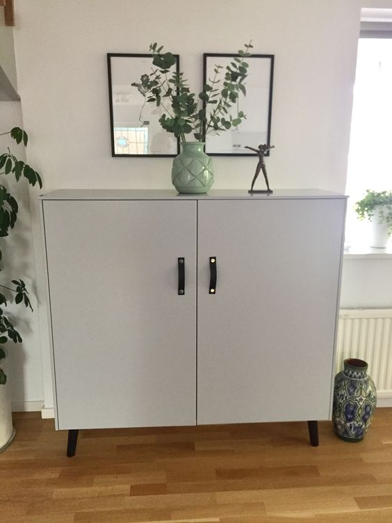 a Metod hack with grey paint, legs and leather handles gives you a Scandinanavian furniture piece