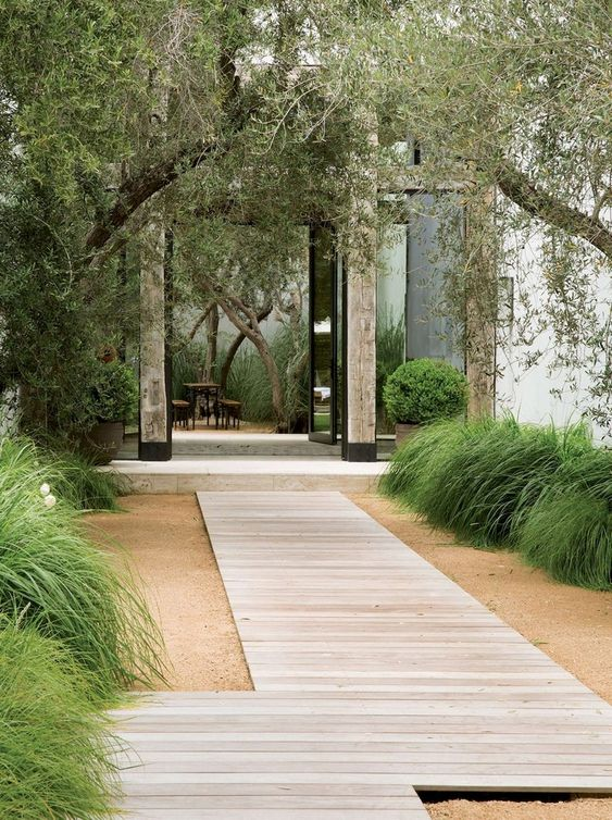 a minimalist wooden plank garden path will harmonize the space even more and will easily match a minimalist or Japanese space