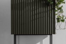 09 a Metod cabinet covered with corrugated steel and placed on tall metal legs will be a nice fit for a living room