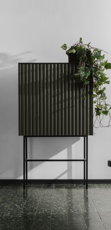 a Metod cabinet covered with corrugated steel and placed on tall metal legs will be a nice fit for a living room